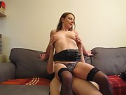 Wife riding husband on the sofa in lingerie