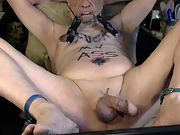 Tony masturbating himself naked with whips, nipple clamps and dildo