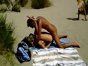 Lucky voyeur films naughty amateurs having beach sex