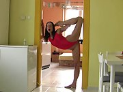 Flexible gymnast fucks a wall dildo in the kitchen