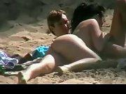 Butt naked girlfriend sucking her boyfriend's fat cock at the beach
