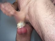 Jerking cock with weighted balls swinging freely and becoming red