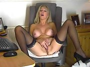 Busty mature blonde strips and masturbates on her cam