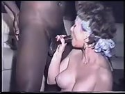 Big tit MILF worships a huge dark boner