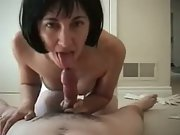 Wife wearing a basque and stockings sucking and riding cock amateur