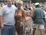 Busty amateur getting lots of attention at a festival