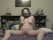 Submissive lady rides huge dildo for her master