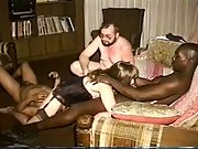 Interracial swing group sex session at home with a horny pretty lady