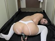 Lovely brunette camgirl masturbates in the corridor